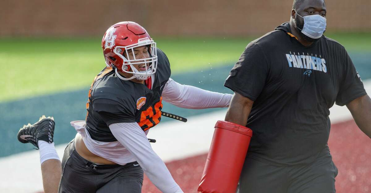 American Team defensive lineman Payton Turner of Houston (98) runs a drill during the American Team practice for the NCAA Senior Bowl college football game in Mobile, Ala. Wednesday, Jan. 27, 2021. (AP Photo/Matthew Hinton)