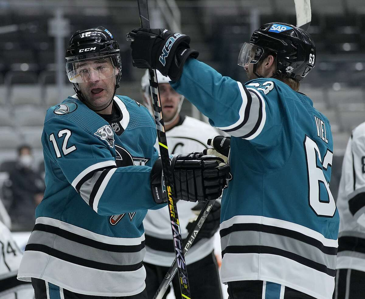 Sharks center Patrick Marleau (12) celebrates with Jeffrey Viel (63) after scoring against the Kings during the first period Friday.
