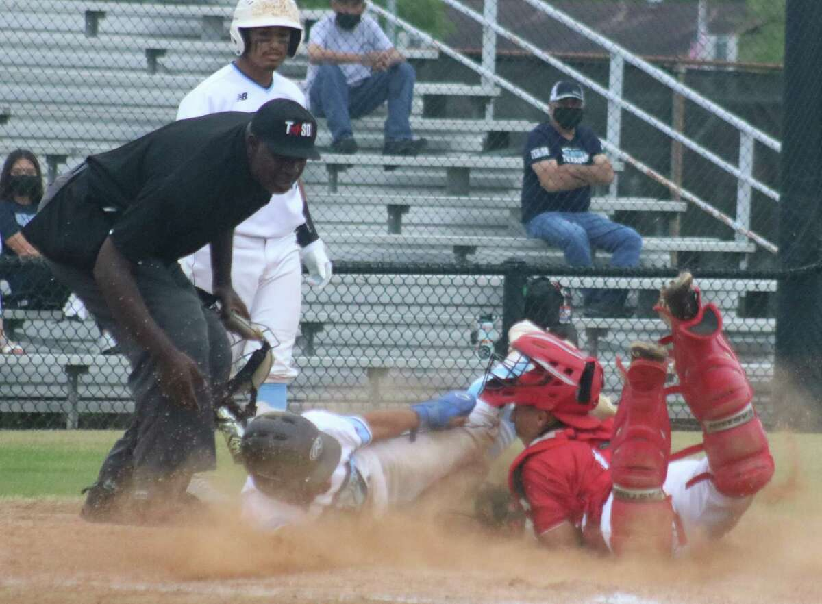 South Houston catcher Erick Renteria tags out Rayburn's Francisco Guerrero, who was attempting to score in the first inning on a pitch that rolled a short distance from the plate area.