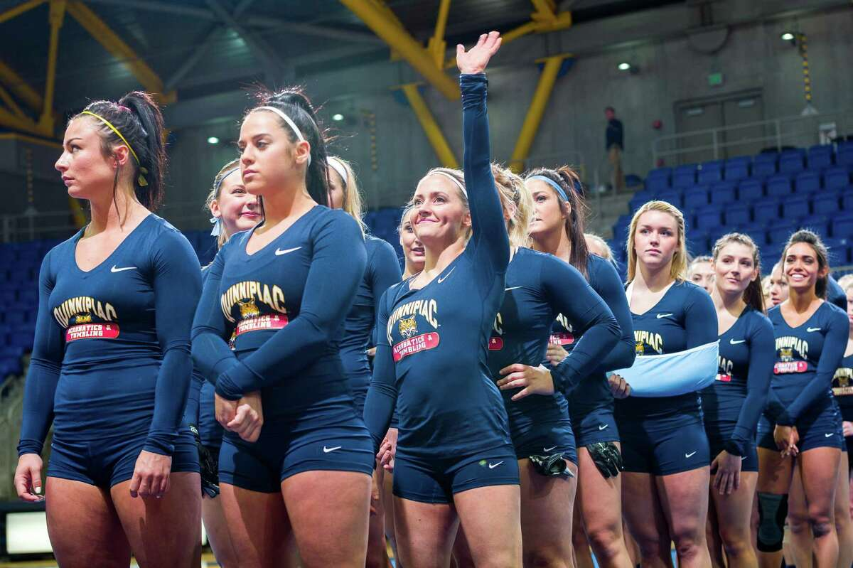 Taylor Johnson (1) competed on Quinnipiac's acrobatics and tumbling team from 2012-16.