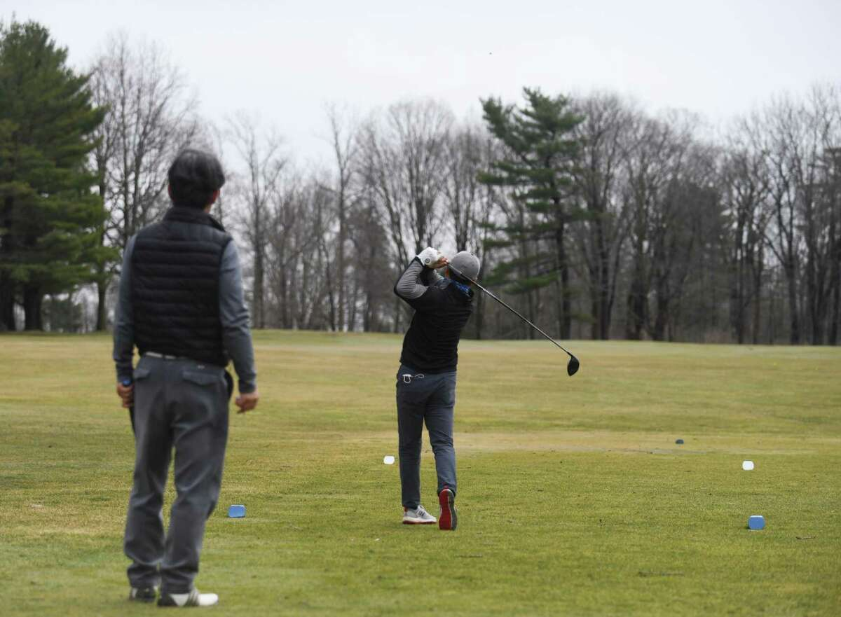Golfers tee off at Griffith E. Harris Golf Course in Greenwich, Conn. Thursday, March 25, 2021.