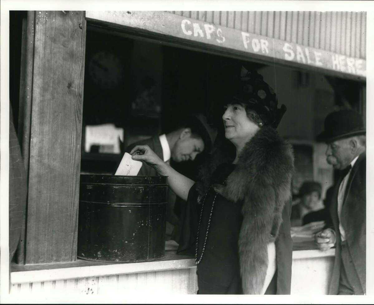 Mrs. L.W. Evans, president of the San Antonio Federation of Women's Clubs, casts a ballot at San Pedro Park Pavilion on November 4, 1924.
