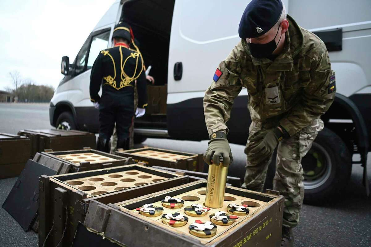 Members of the King's Troop Royal Horse Artillery place empty shells into boxes in advance of firing a 41-round gun salute at Woolwich Barracks, to mark the death of Prince Philip, in London, Saturday, April 10, 2021. Britain's Prince Philip, the irascible and tough-minded husband of Queen Elizabeth II who spent more than seven decades supporting his wife in a role that mostly defined his life, died on Friday. (Daniel Leal-Olivas/Pool Photo via AP)