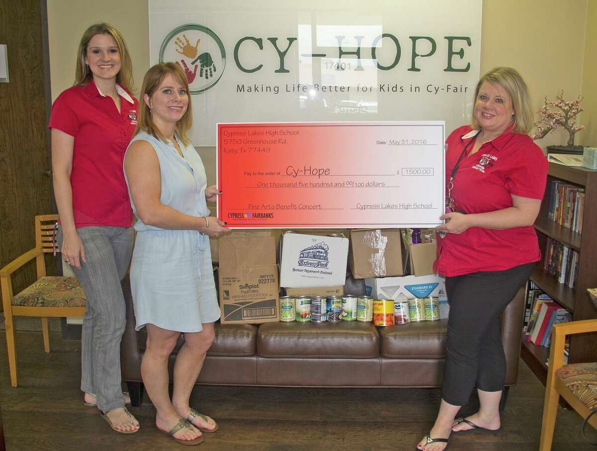 Cy Lakes Choir 2: The Cypress Lakes choir raised $1,500 for flood victims through a fine arts benefit concert at the school on May 16. Choir director Lelah Loftin, right, and assistant director Rebecca Vaughn, left, deliver the check to Cy-Hope Counseling clinical director Amy Rollo on June 1.