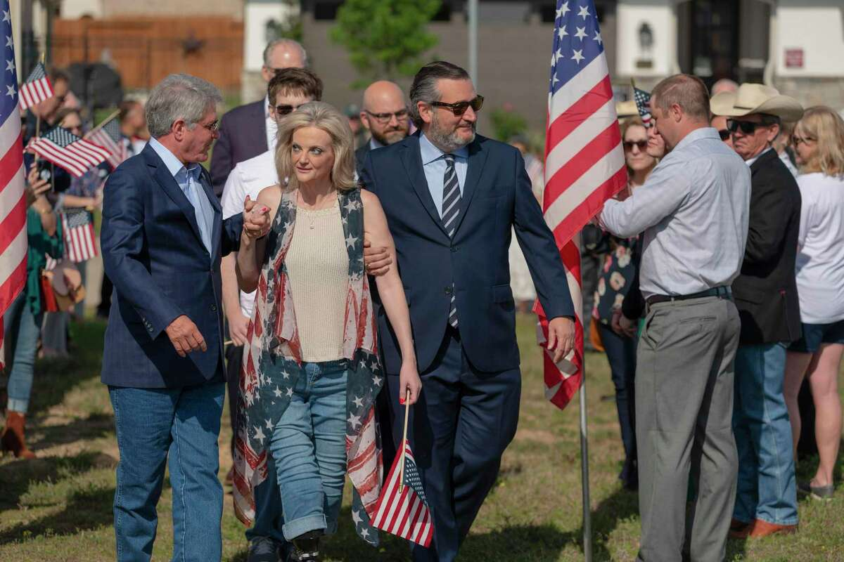 Sue Downs, Cpl., U.S. Army Retired, receives an escort from Congressman Michael McCaul (left) and U.S. Senator Ted Cruz to the site of the groundbreaking for her new, modified home in Towne Lake in the Cypress area.