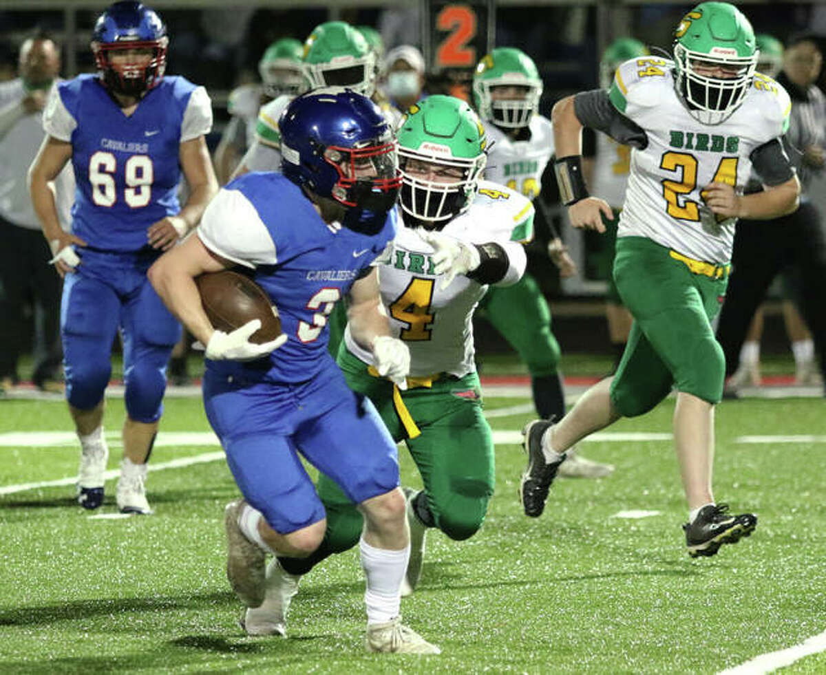 Carlinville running back Bobby Seals (3) eludes Southwestern linebacker Blake Funk to pick up some of his 231 rushing yards Friday night in the Cavaliers' 39-13 SCC victory in Carlinville.
