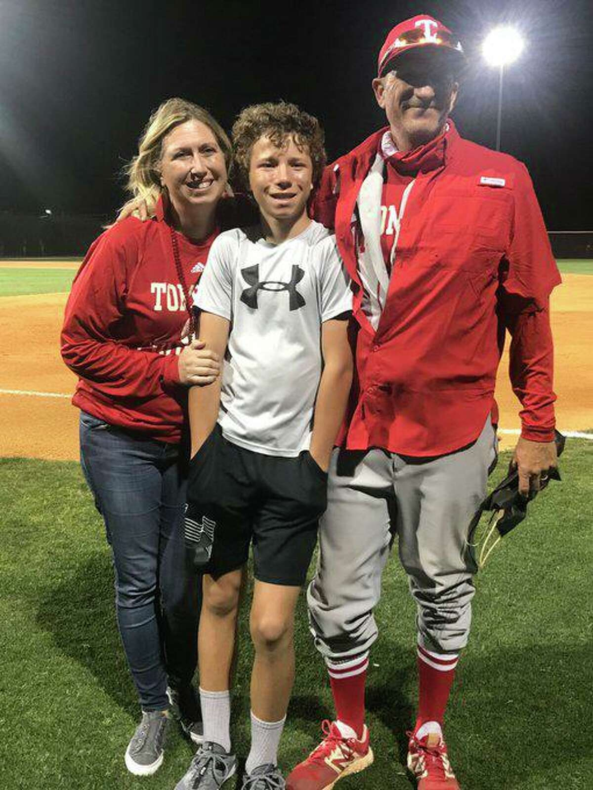 Tomball baseball coach Doug Rush is joined by his wife and son. Rush earned his 500th career win in a 2-0 victory against Klein Oak Tuesday, April 6, at Tomball High School.
