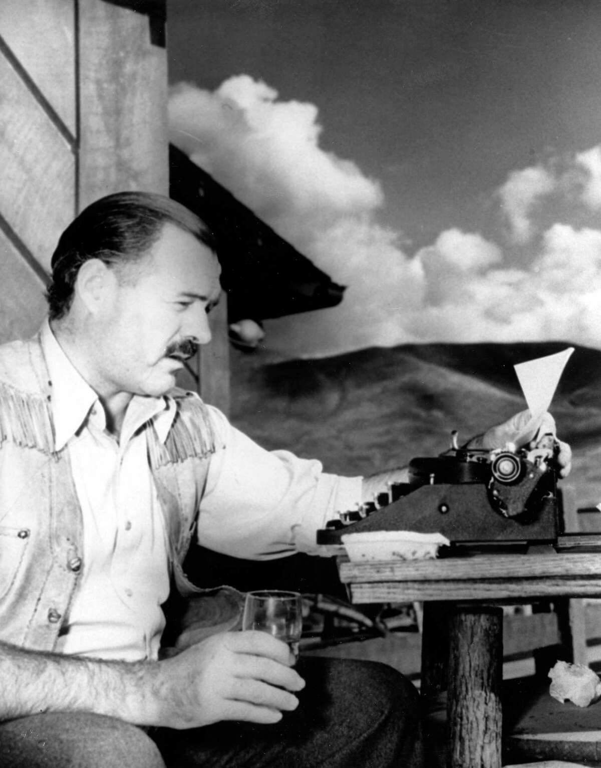 """Ernest Hemingway is shown at his typewriter as he works """"For Whom the Bell Tolls"""" at Sun Valley Lodge, Idaho, in 1939."""