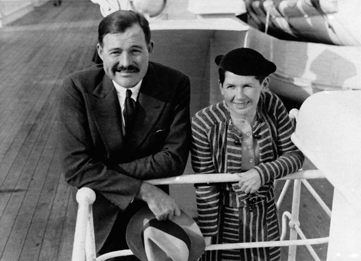 """In this April 3, 1934 file photo, author Ernest Hemingway and his wife Pauline Pfeiffer arrive in New York aboard the liner """"Paris,"""" after a three-month vacation in eastern Africa hunting lions."""