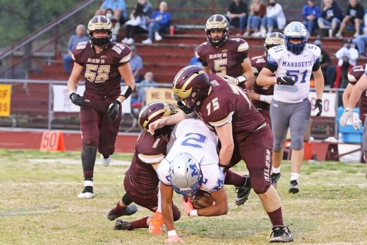 Marquette's Zach Smith (2) is tackled by EA-WR's Jacob Weller (75) and Brenden Noel on Friday night in Wood River.