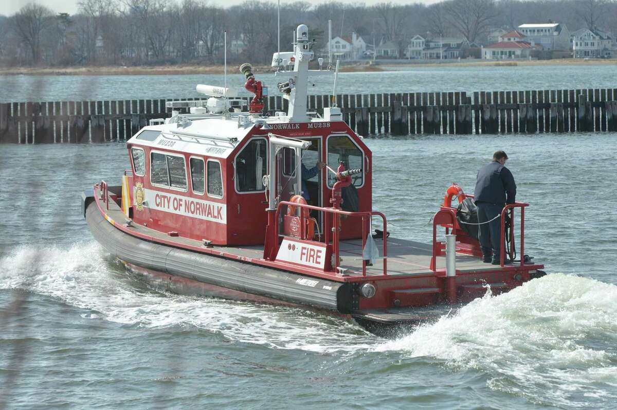 The fire department's marine unit rescued four individuals in the waters off Norwalk, Conn., after the boat they were on capsized Wednesday, July 28, 2021.