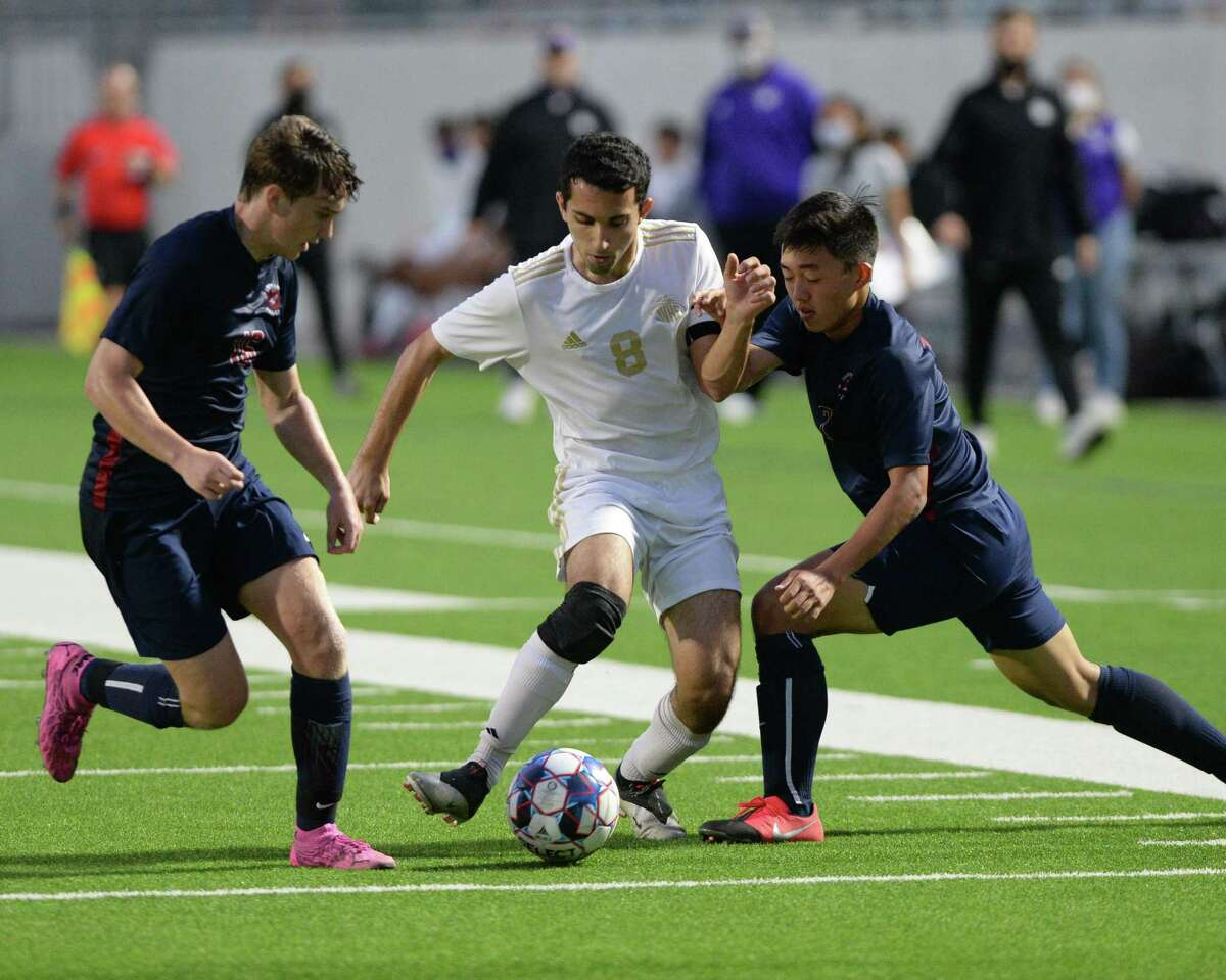 Saleem Joubran (8) of Jersey Village is challenged by Alec Shockley (16) and Yuta Tsukamoto (7) of Tompkins during the first half of the region 6A-III soccer championship between the Tompkins Falcons and the Jersey Village Falcons on Friday, April 9, 2021 at Legacy Stadium, Katy, TX.