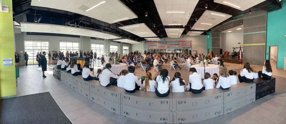Choir students sit in the uniquely designed cafetorium of the new Fox Elementary before the ceremony gets underway. The new school opened in September of 2020.