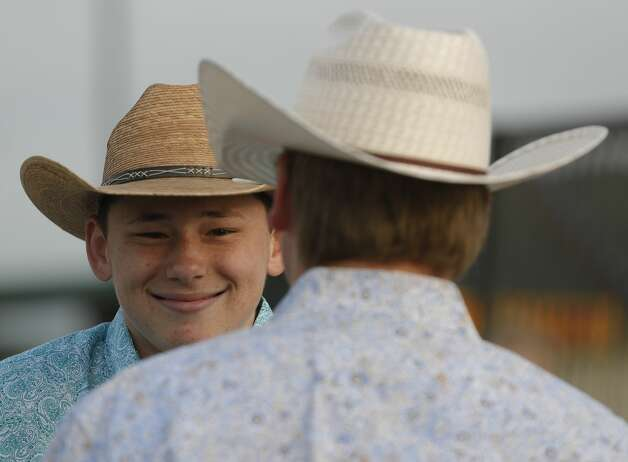 Joshua Baldwin, left, laughs with Kaleb Sprayberry before showing their cooker at the ag mechanics competition judges during the Montgomery County Fair and Rodeo, Saturday, April 10, 2021, in Conroe. Ag Mechanics prepares students for careers related to the construction, operation, and maintenance of equipment used by the agriculture industry. Photo: Jason Fochtman/Staff Photographer / 2021 ? Houston Chronicle
