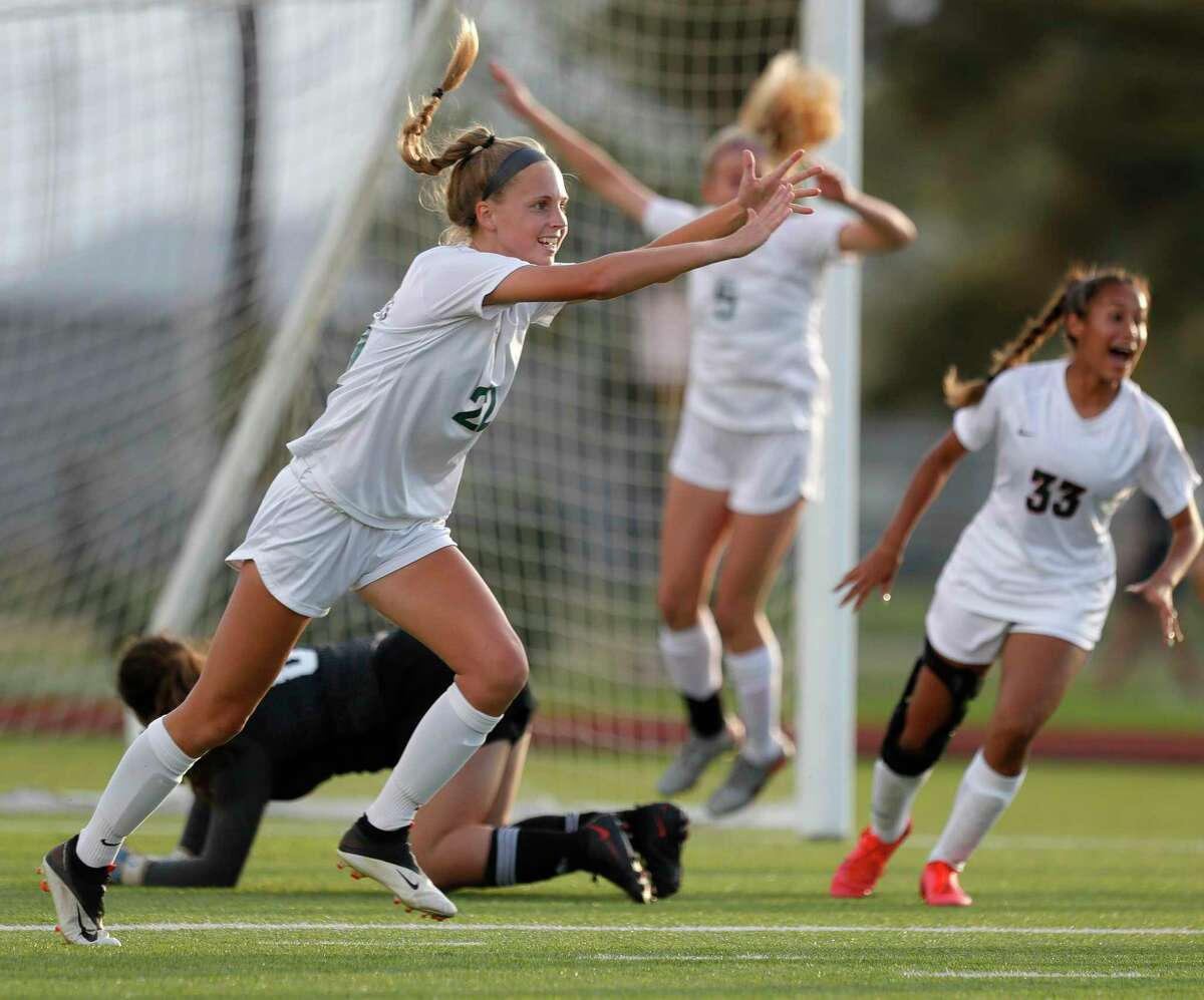 Janey Kauppinen (22) and The Woodlands will be playing in the Class 6A state semifinals after beating Lake Ridge to win the Region II-6A championship.
