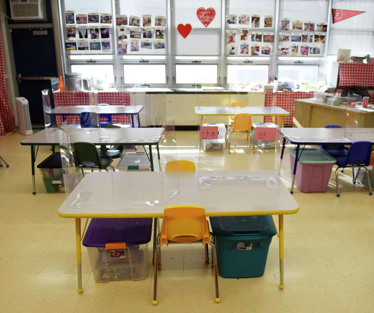 Classrooms are set up with COVID-19 precautions in place at Northeast Elementary School in Stamford, Conn. Monday, March 8, 2021.
