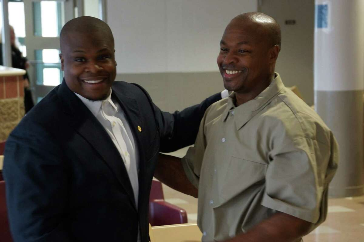 Tony Lewis Sr., right, with his son Tony Lewis Jr., who is calling on President Biden to free his father from prison.