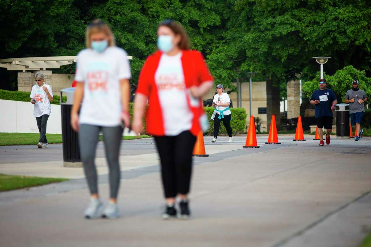 Participants complete one of eight laps around the Astrodome during the inaugural Race For the Dome, a fun run hosted by the Astrodome Conservancy on Saturday, April 10, 2021.