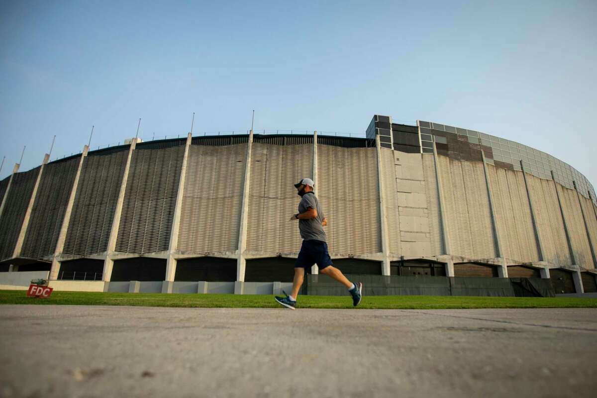 A runner completes one of eight laps around the Astrodome during the inaugural Race For the Dome, a fun run hosted by the Astrodome Conservancy on Saturday, April 10, 2021.