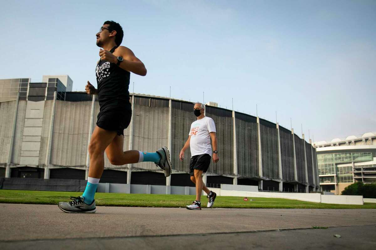 Eugene Olivarez and Bobby Tudor complete laps around the Astrodome during the inaugural Race For the Dome, a fun run hosted by the Astrodome Conservancy on Saturday, April 10, 2021.