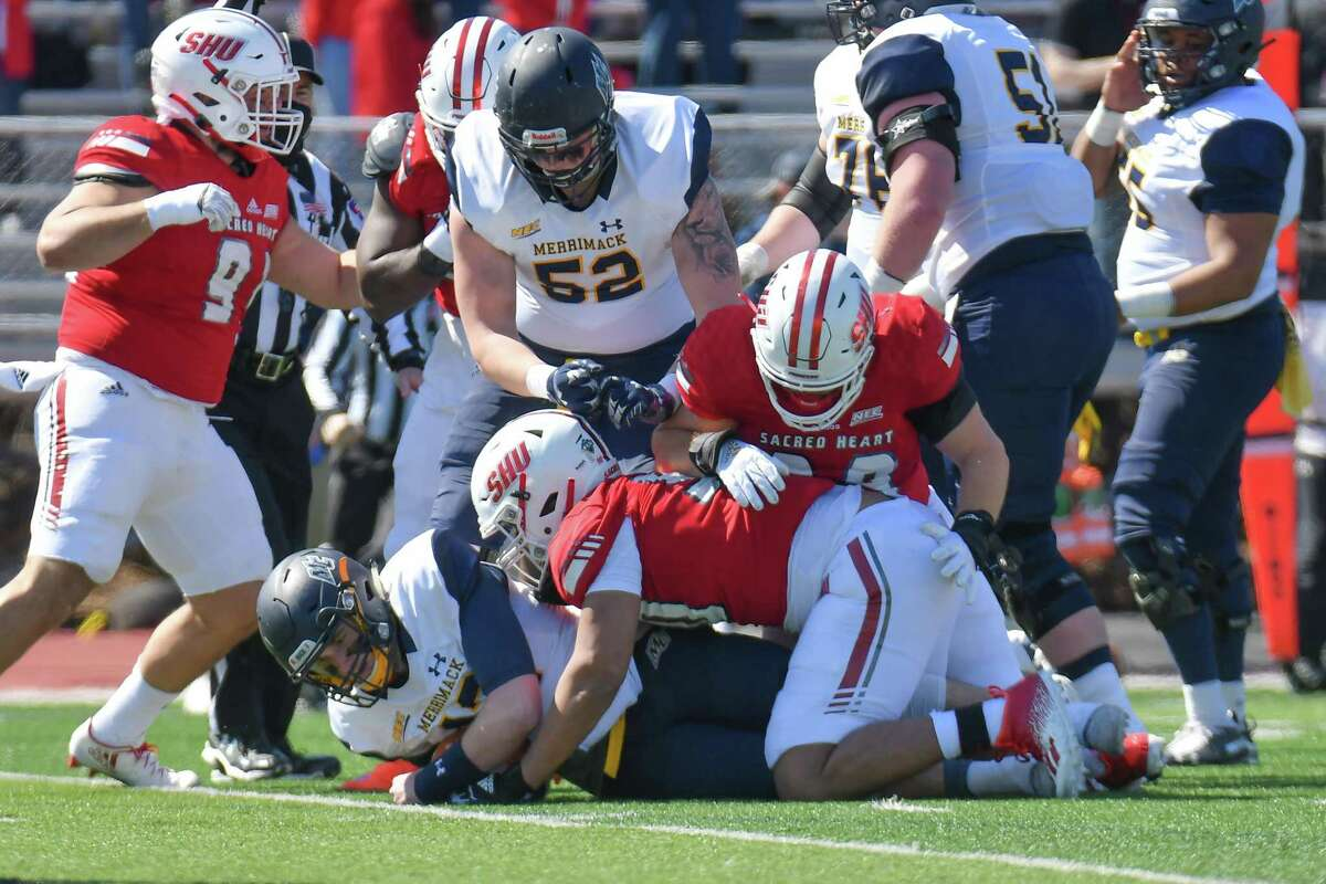 The Sacred Heart defense makes a tackle during a 26-9 win over Merrimack in March in Fairfield.