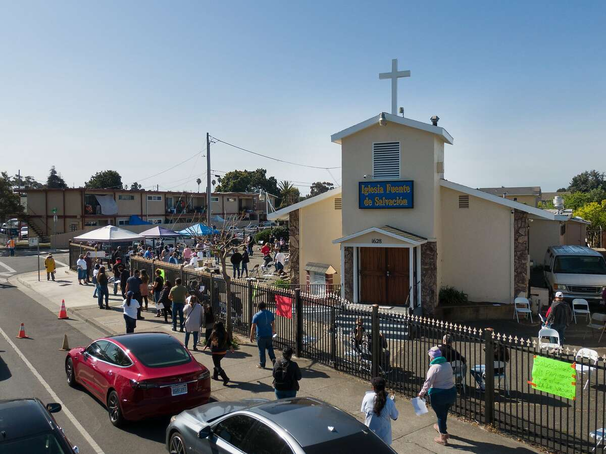 A line forms at the Iglesia Fuente De Salvacion Church where the Community Clinic Consortium in Contra Costa and Solano Counties hosted a free vaccination clinic on Saturday, April 10, 2021 in San Pablo, Calif.