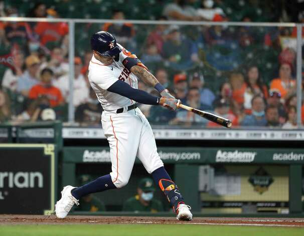 Houston Astros Carlos Correa (1) hits a single during the first inning of an MLB baseball game at Minute Maid Park, in Houston, Saturday, April 10, 2021. Photo: Karen Warren, Staff Photographer / @2021 Houston Chronicle