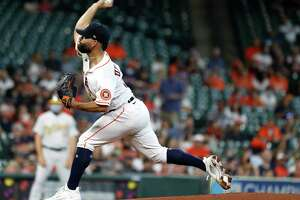 Houston Astros starting pitcher Jose Urquidy (65) pitches during the first inning of an MLB baseball game at Minute Maid Park, in Houston, Saturday, April 10, 2021.