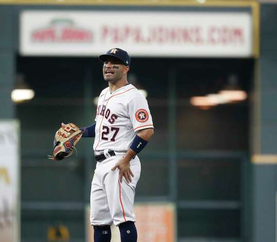 Houston Astros second baseman Jose Altuve (27) chats with Oakland Athletics Elvis Andrus (17) at first base during the third inning of an MLB baseball game at Minute Maid Park, in Houston, Saturday, April 10, 2021. Photo: Karen Warren, Staff Photographer / @2021 Houston Chronicle
