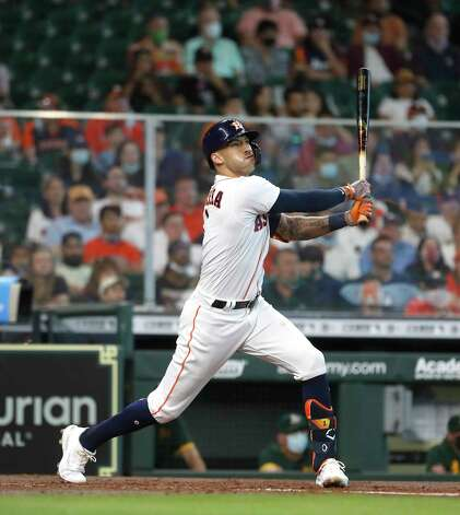 Houston Astros shortstop Carlos Correa (1) flies out during the third inning of an MLB baseball game at Minute Maid Park, in Houston, Saturday, April 10, 2021. Photo: Karen Warren, Staff Photographer / @2021 Houston Chronicle