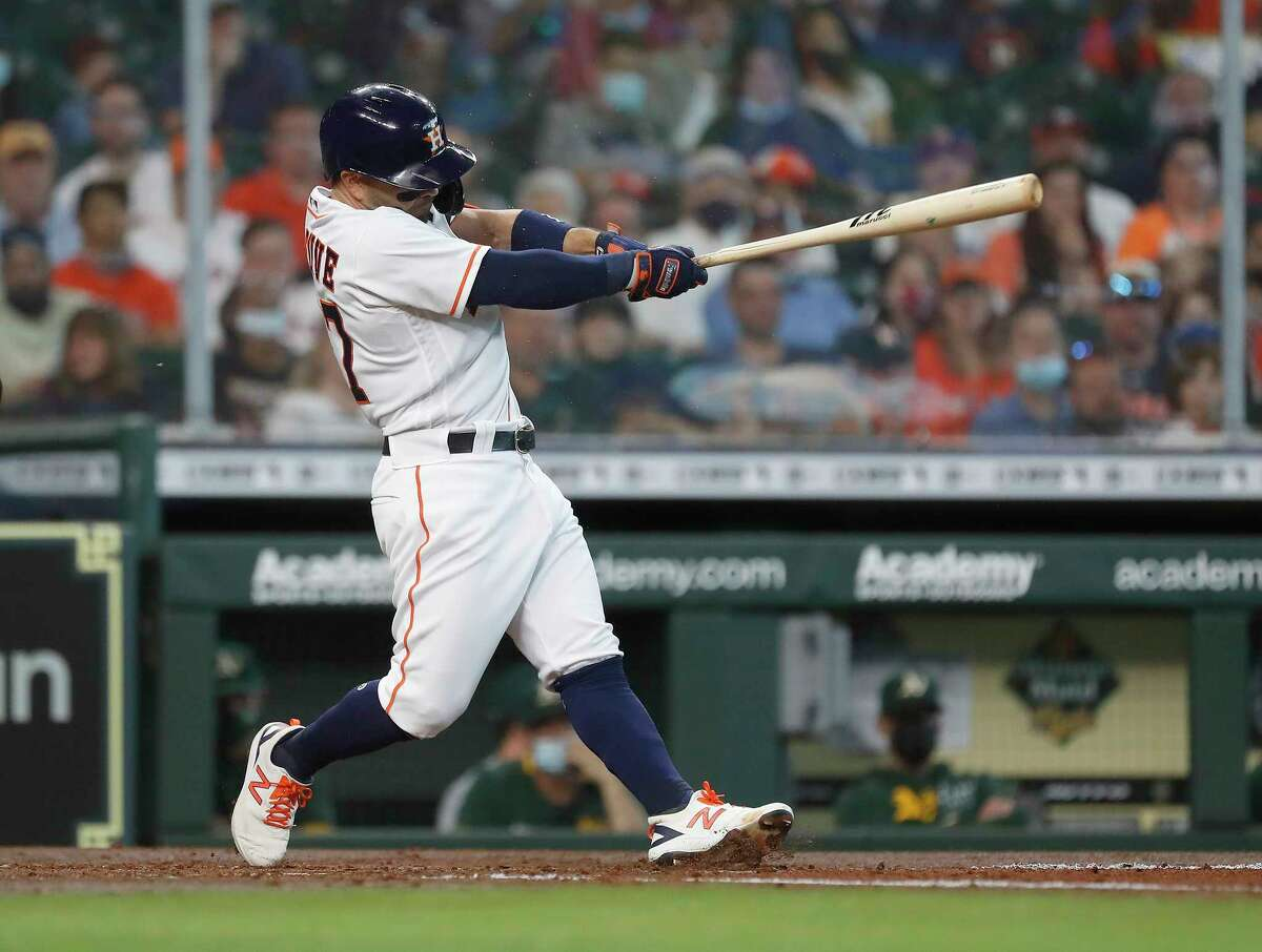 Houston Astros Jose Altuve (27) doubles off Oakland Athletics starting pitcher Frankie Montas during the third inning of an MLB baseball game at Minute Maid Park, in Houston, Saturday, April 10, 2021.