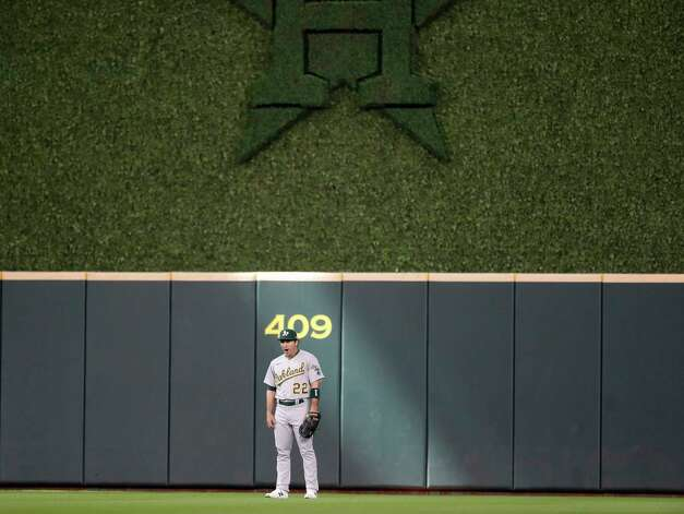 Oakland Athletics center fielder Ramon Laureano (22) stands in a ray of sunshine in center field during the third inning of an MLB baseball game at Minute Maid Park, in Houston, Saturday, April 10, 2021. Photo: Karen Warren, Staff Photographer / @2021 Houston Chronicle