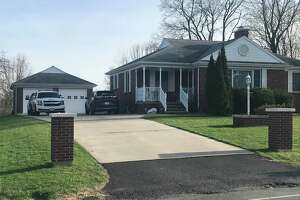 A Colonie police SUV is parked in the driveway of 520 Boght Road, Colonie, N.Y. with two other vehicles as police investigate Saturday April 10, 2021 the shooting deaths of two people, one of whom had self-inflicted gunshot wounds.