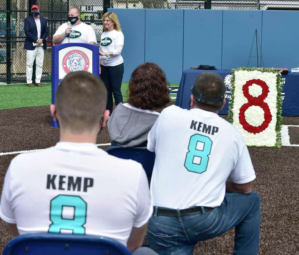 """Cliff and Melinda Kemp, the parents of Foran softball player Danielle """"Danni"""" Kemp, who lost her battle with cancer at 19, speak during the dedication of the Foran High School Danielle Kemp Memorial Softball Field."""