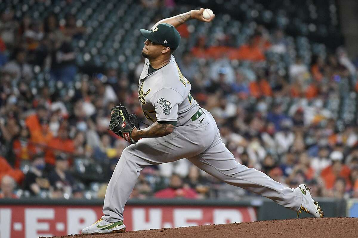 Oakland Athletics starting pitcher Frankie Montas delivers during the first inning of a baseball game against the Houston Astros, Saturday, April 10, 2021, in Houston. (AP Photo/Eric Christian Smith)