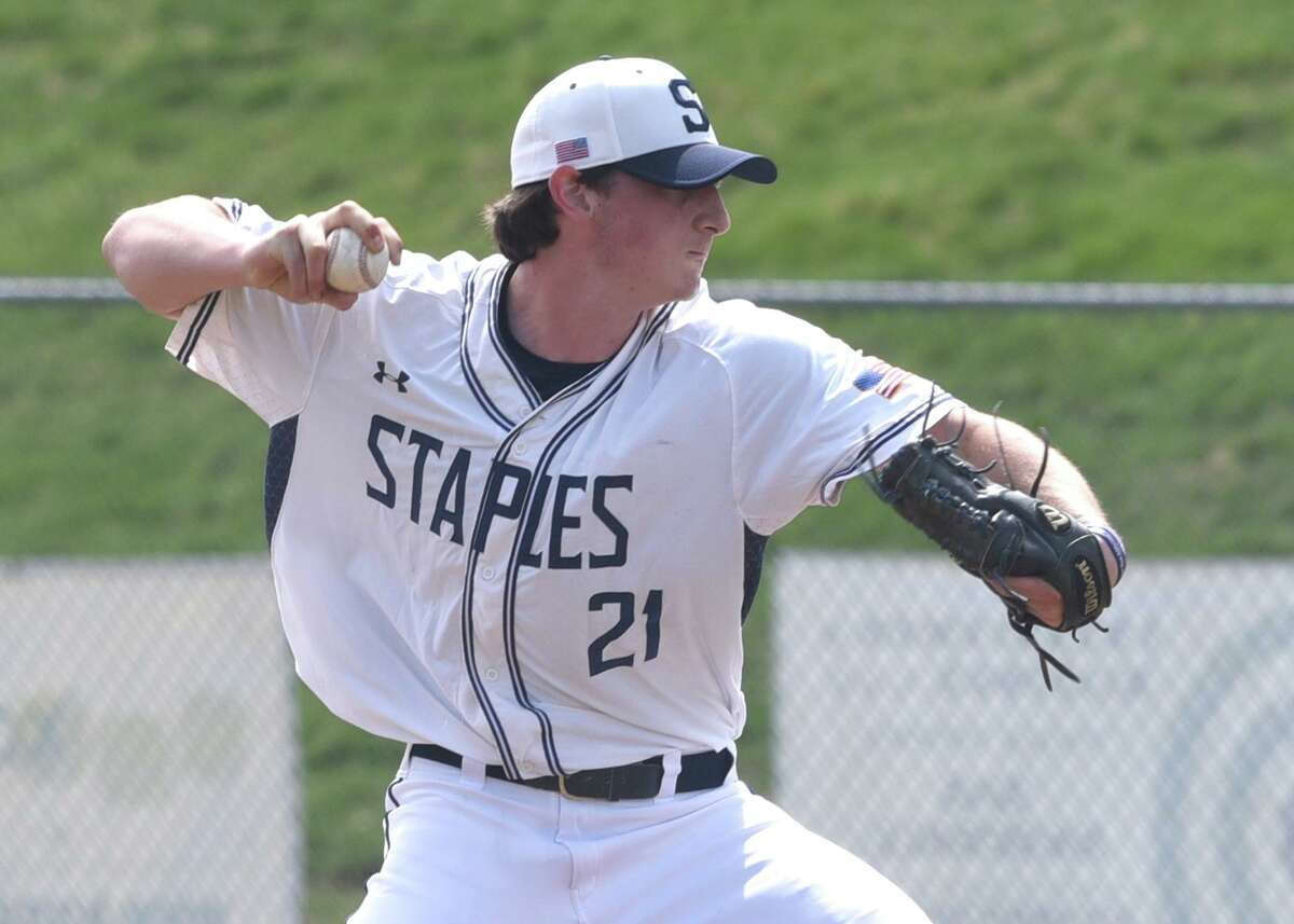 Staples' Carter Kelsey (21) fires in a pitch during the Wreckers' baseball game against Darien in Westport on Saturday, April 10, 2021. Kelsey and Matt Spada combined on a no-hitter.