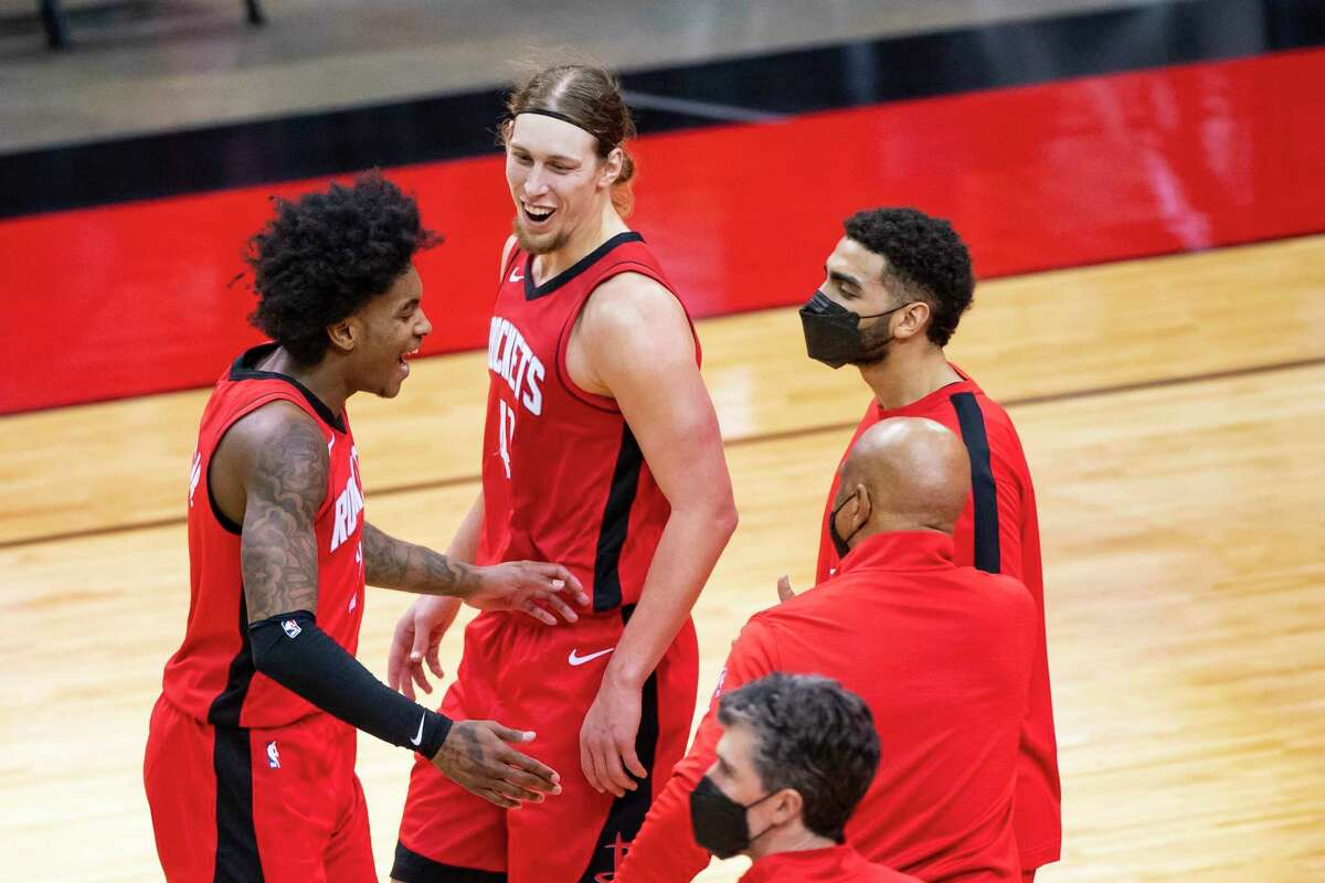 Rockets guard Kevin Porter Jr. and foward Kelly Olynyk were able to celebrate on Wednesday with a win over the Mavericks.