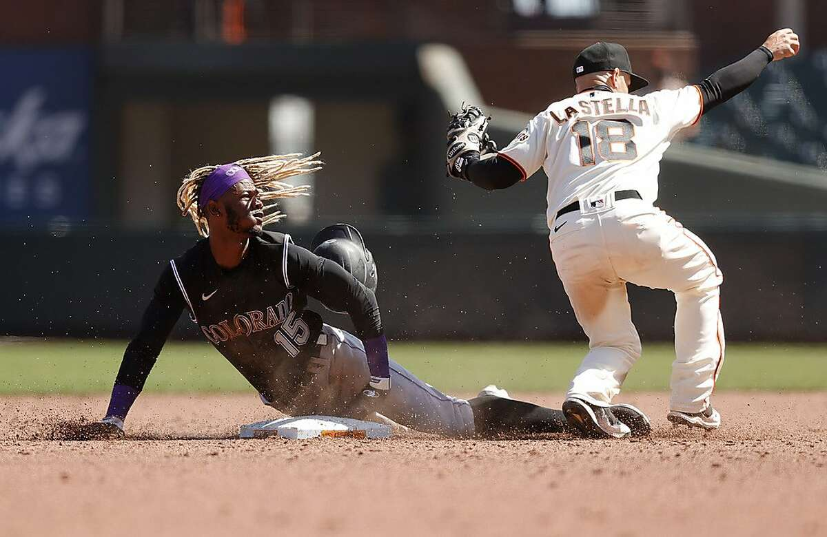 SAN FRANCISCO, CALIFORNIA - APRIL 10: Raimel Tapia #15 of the Colorado Rockies is tagged out by Tommy La Stella #18 of the San Francisco Giants on a stolen base attempt in the sixth inning at Oracle Park on April 10, 2021 in San Francisco, California. (Photo by Ezra Shaw/Getty Images)