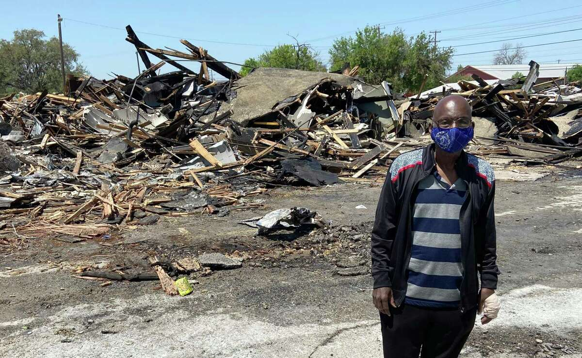 Rev. Johnnie Guyton, 79, stands in front of the charred rubble that's all that remains of his East Side church Saturday, April 10, 2021. Huntleigh Park Baptist Church caught fire late Friday night, but the blaze swept through the largely wooden structure so quickly, it was totally destroyed before firefighters could extinguish it. No injuries were reported.