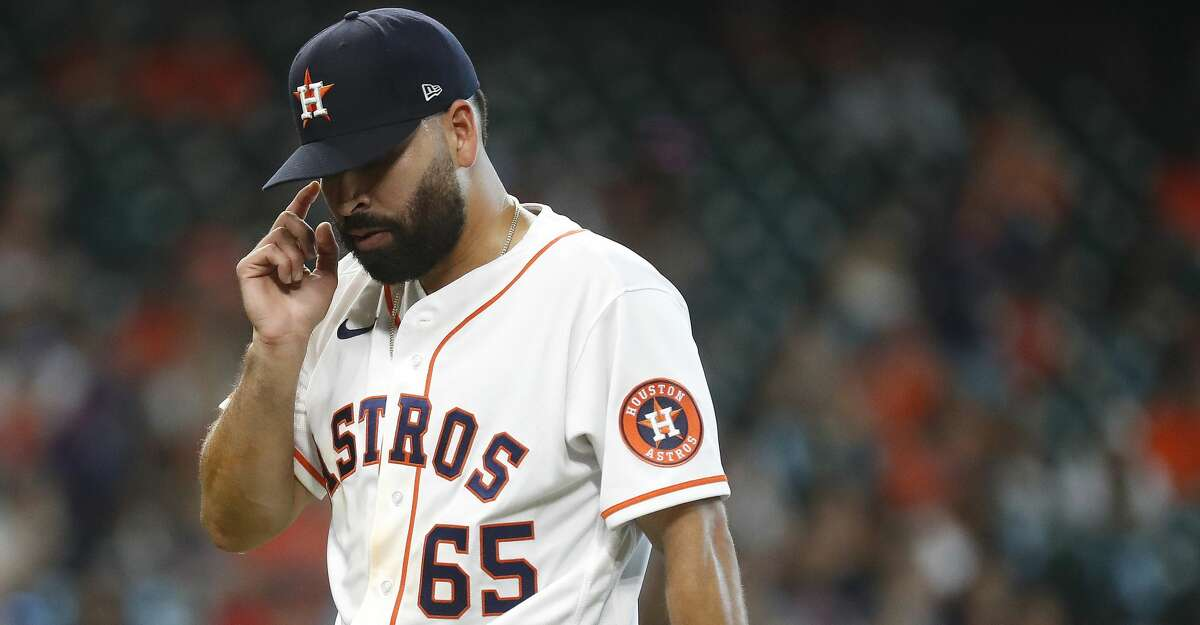 Houston Astros starting pitcher Jose Urquidy (65) reacts after getting out of the fifth inning of an MLB baseball game at Minute Maid Park, in Houston, Saturday, April 10, 2021.