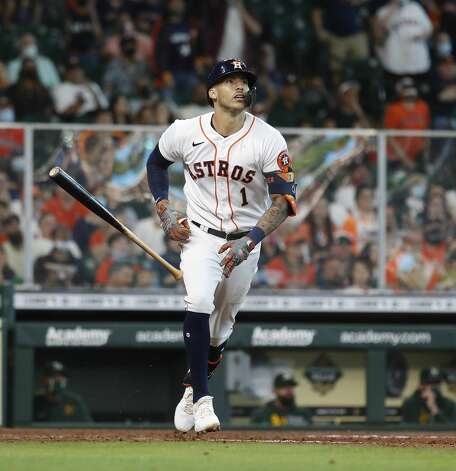 Houston Astros Carlos Correa (1) tosses his bat as he watches his fly out during the seventh inning of an MLB baseball game at Minute Maid Park, in Houston, Saturday, April 10, 2021. Photo: Karen Warren/Staff Photographer / @2021 Houston Chronicle