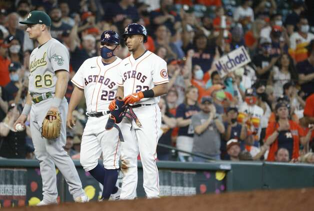 Houston Astros Michael Brantley (23) stands on third base after hitting an RBI triple during the seventh inning of an MLB baseball game at Minute Maid Park, in Houston, Saturday, April 10, 2021. Photo: Karen Warren/Staff Photographer / @2021 Houston Chronicle