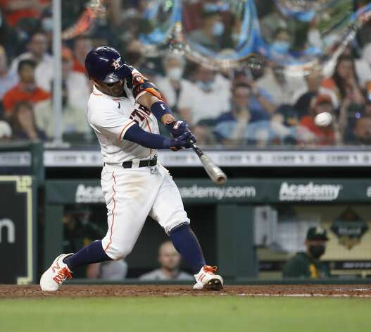Houston Astros Jose Altuve (27) hits an RBI double during the seventh inning of an MLB baseball game at Minute Maid Park, in Houston, Saturday, April 10, 2021. Photo: Karen Warren/Staff Photographer / @2021 Houston Chronicle
