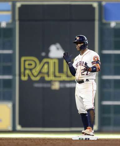 Houston Astros Jose Altuve (27) stands on second base after hitting an RBI double during the seventh inning of an MLB baseball game at Minute Maid Park, in Houston, Saturday, April 10, 2021. Photo: Karen Warren/Staff Photographer / @2021 Houston Chronicle