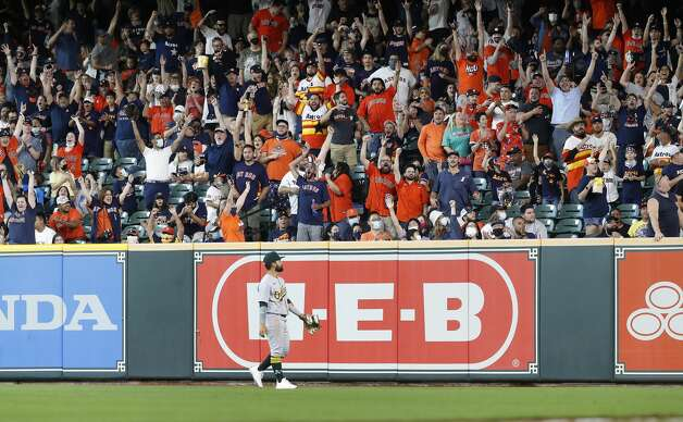 Fans react after Houston Astros Kyle Tucker hit a home run off of Oakland Athletics starting pitcher Frankie Montas during the seventh inning of an MLB baseball game at Minute Maid Park, in Houston, Saturday, April 10, 2021. Photo: Karen Warren/Staff Photographer / @2021 Houston Chronicle