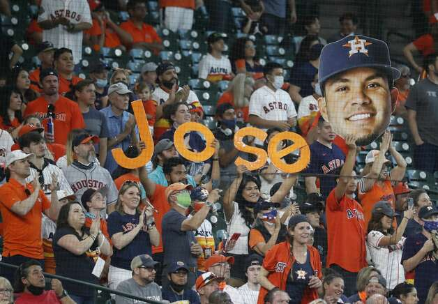 Fans cheer for Houston Astros Jose Altuve after he hit an RBI double during the seventh inning of an MLB baseball game at Minute Maid Park, in Houston, Saturday, April 10, 2021. Photo: Karen Warren/Staff Photographer / @2021 Houston Chronicle