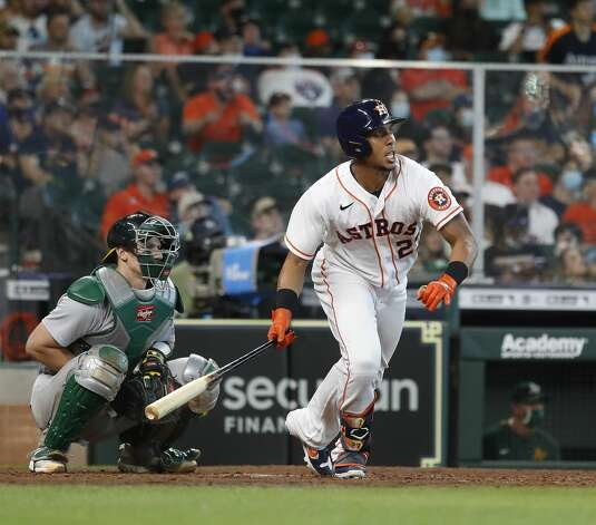 Houston Astros Michael Brantley (23) hits an RBI triple during the seventh inning of an MLB baseball game at Minute Maid Park, in Houston, Saturday, April 10, 2021. Photo: Karen Warren/Staff Photographer / @2021 Houston Chronicle