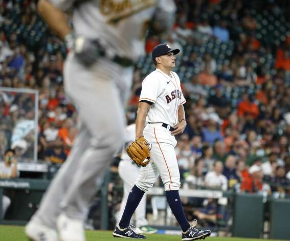Houston Astros relief pitcher Brandon Bielak (64) reacts after walking Oakland Athletics Ramon Laureano (22) during the seventh inning of an MLB baseball game at Minute Maid Park, in Houston, Saturday, April 10, 2021. Photo: Karen Warren/Staff Photographer / @2021 Houston Chronicle