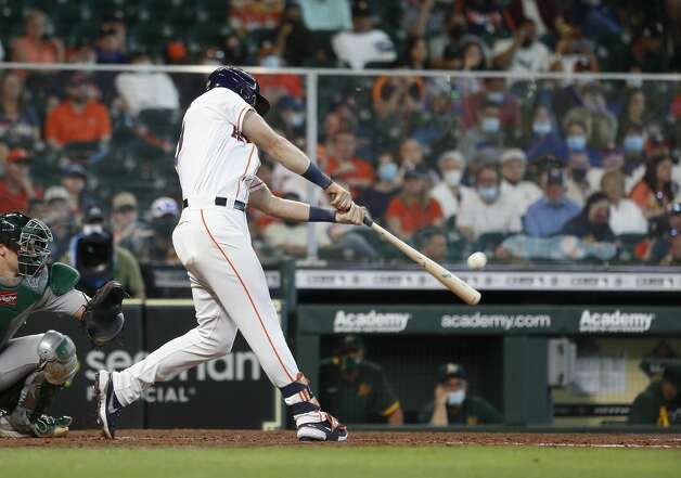 Houston Astros Kyle Tucker (30) hits a home run off of Oakland Athletics starting pitcher Frankie Montas during the seventh inning of an MLB baseball game at Minute Maid Park, in Houston, Saturday, April 10, 2021. Photo: Karen Warren/Staff Photographer / @2021 Houston Chronicle