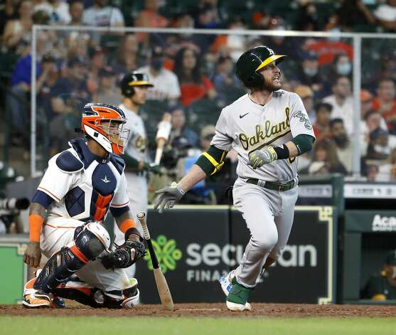 Oakland Athletics Jed Lowrie (8) hits an RBI single off of Houston Astros relief pitcher Brandon Bielak during the seventh inning of an MLB baseball game at Minute Maid Park, in Houston, Saturday, April 10, 2021. Photo: Karen Warren/Staff Photographer / @2021 Houston Chronicle